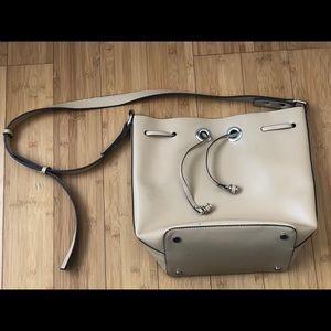 Cream colored shoulder bag with silver hardware